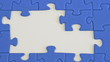 building a jigsaw of blue pieces with hand