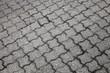 Background texture of gray urban cobblestone road