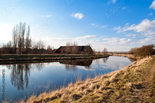 Dutch farm house by river
