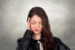 Brunette girl with headache