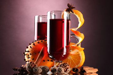 mulled wine in the glasses, spice and orange