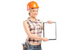Female worker showing a blank clipboard