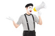 Male mime artist speaking at loudspeaker and looking at camera