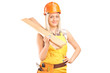 Smiling female carpenter with helmet holding sills