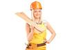 Smiling female carpenter with helmet holding sills