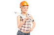 Smiling female worker with helmet holding a construction bubble