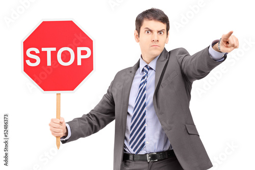 Man in suit holding a stop sign