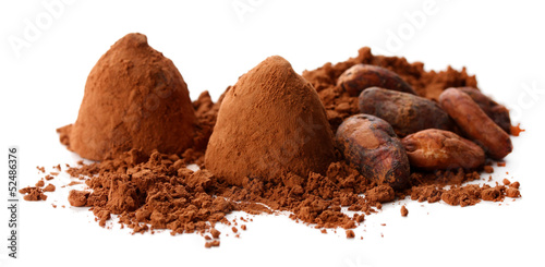 Chocolate truffles and cocoa isolated on white
