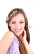 Young woman with beautiful hairstyle and wreath, isolated