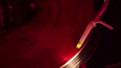 Music record close up, turntable stylus playing in nightclub