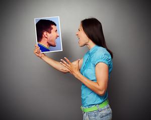 couple in quarrel over dark background