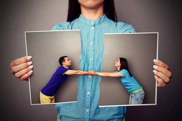 girl holding the torn photo of couple