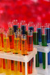 Colorful test tubes on bright background