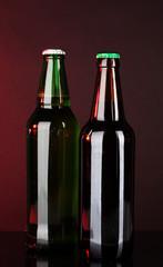 Bottles of beer on brown background