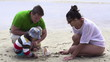 Family on beach with beautiful seashell, super slow motion