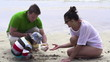 Family on beach with beautiful seashell