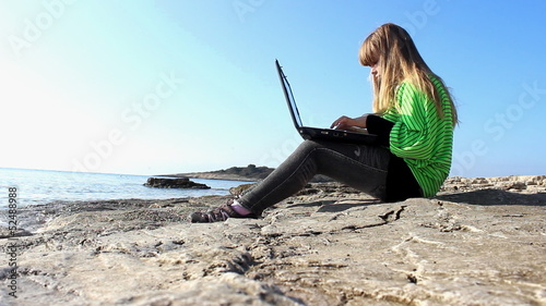 Typing on the beach