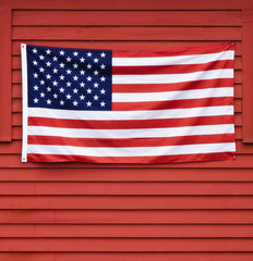 American flag displayed on red wooden wall