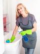 Woman washing sink
