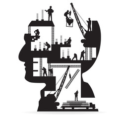 Building under construction with workers in sIlhouette head