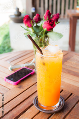 Relaxing time with fresh iced orange juice