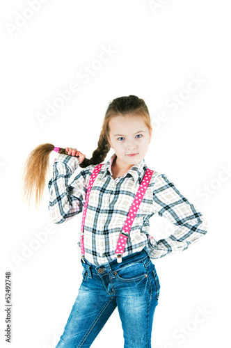 girl with long braid in a plaid shirt and jeans