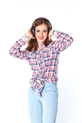 young and beautiful woman listening to music on headphones