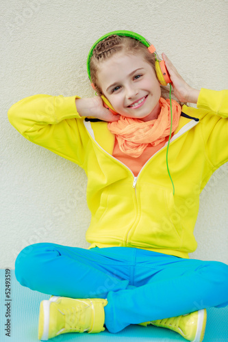 Cute young girl enjoying music
