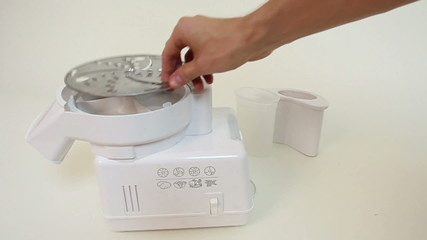 Electric slicer blades change. Food processor.