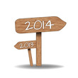 Wooden signs indicating the way for 2014