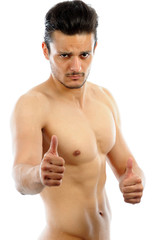Muscular Man pointing OK isolated white background