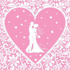 kissing groom and bride on lace background