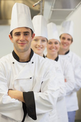 Chefs in line smiling