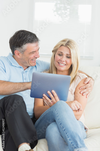 Wife and husband using tablet pc together