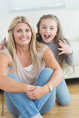 Little girl about to scare her mother
