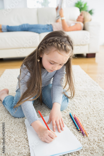 Little girl sitting at the floor