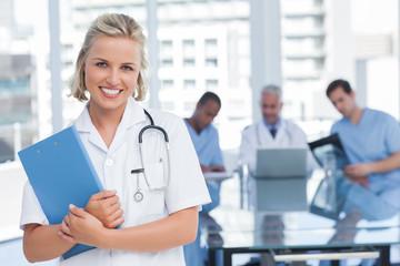 Smiling nurse holding file