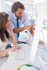 Creative team looking at computer
