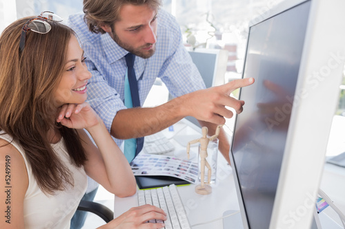 Man pointing something to his partner on screen
