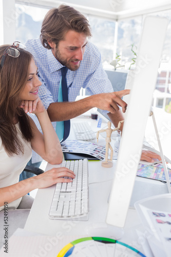 Creative team looking at computer