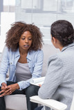Patient sitting on sofa and talking to therapist
