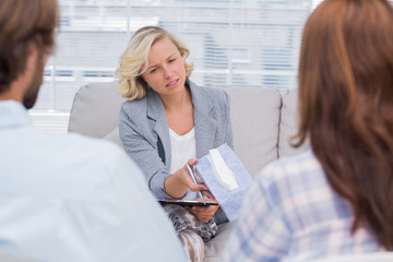 Therapist giving tissue to a woman