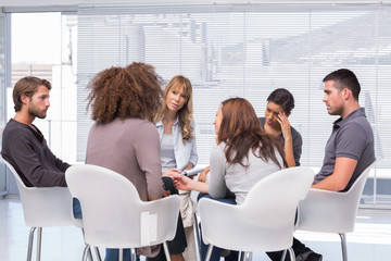Patients around therapist in group therapy session