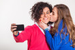 Two Beautiful Women Taking Self Portrait with Mobile Phone