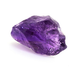 Big raw brazilian amethyst rock isolated on white.
