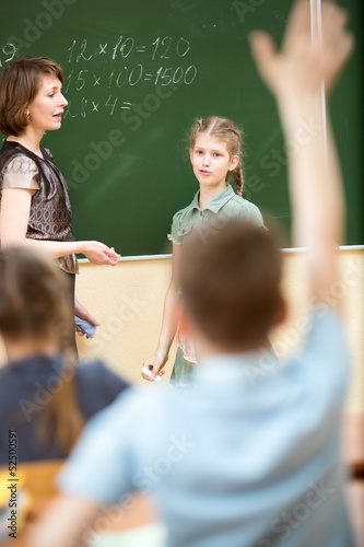 School kids in classroom at math lesson