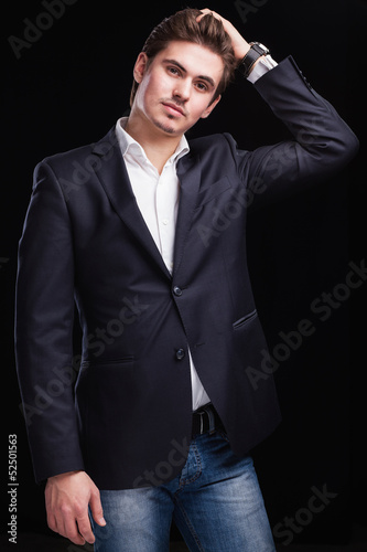 Fashion young businessman black suit