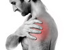 Closeup of young man having pain in shoulder
