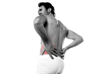 Young man suffers from lower back pain