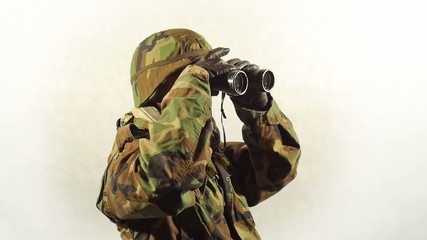 Masked soldier with binoculars.